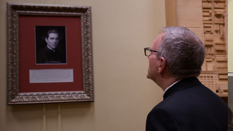 Bishop Barron looking at image of Fulton Sheen