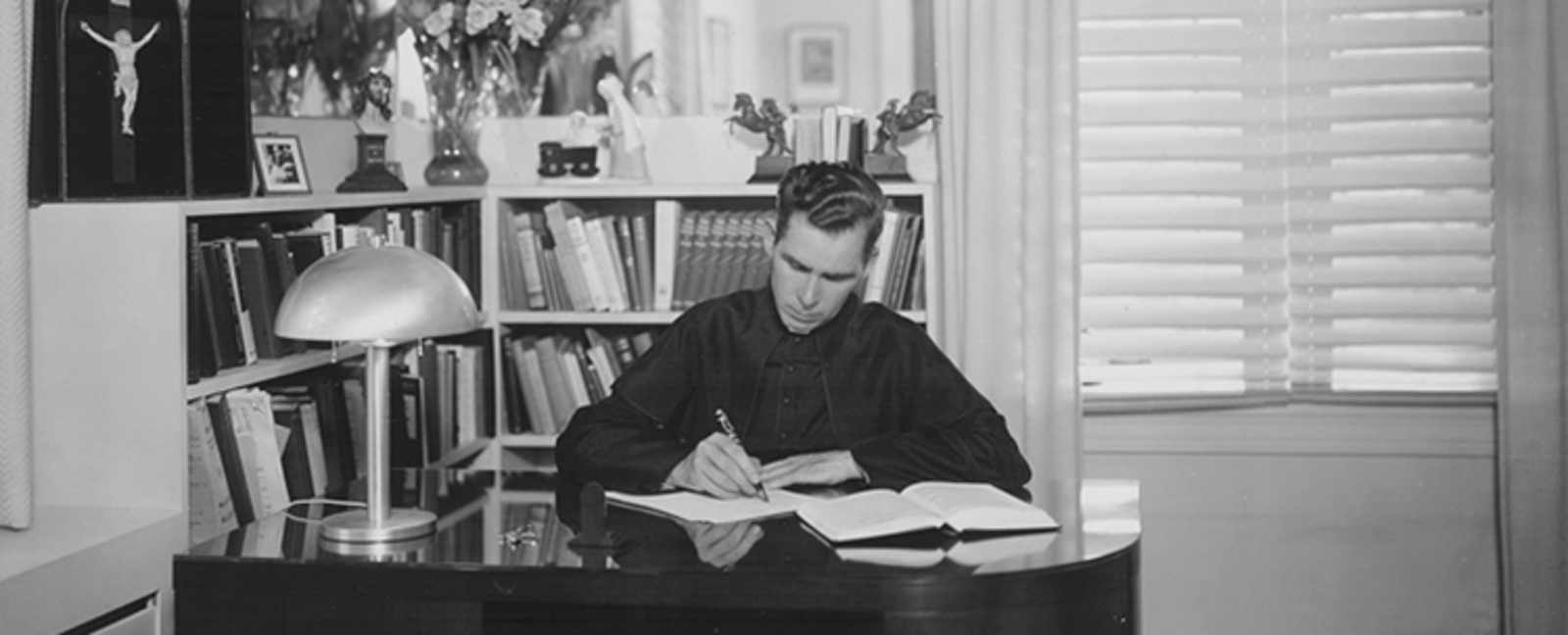 Fulton Sheen working at his desk