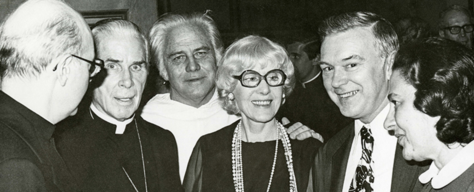 Sheen with Rev. Gilbert Hartke, O.P., Clare Boothe Luce, and University President Clarence C. Walton